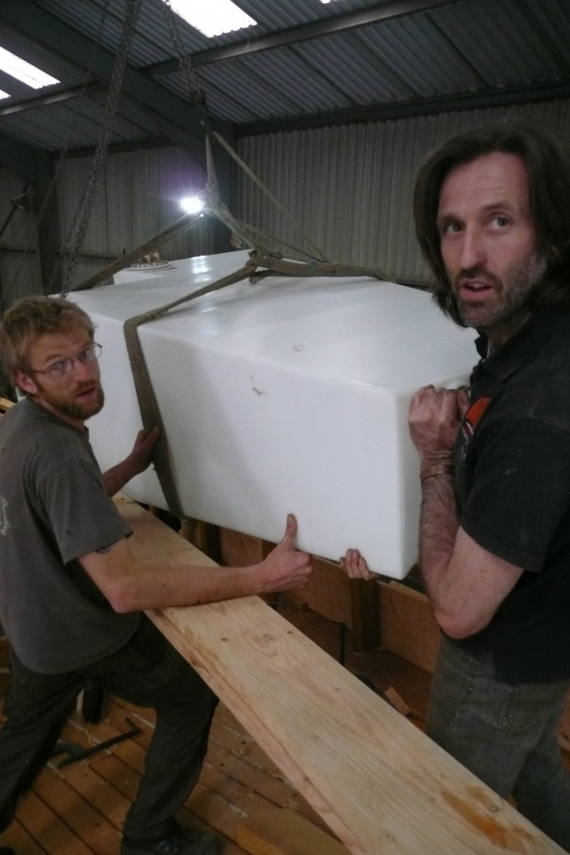 Marcus and Marcus moving the tank into place